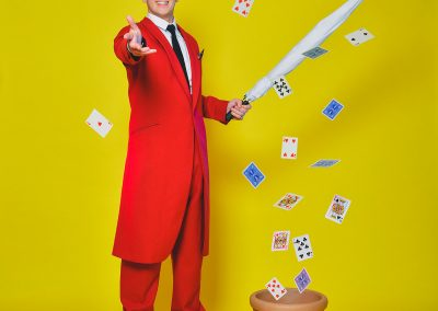 Danny Lee Grew throws playing cards towards the viewer