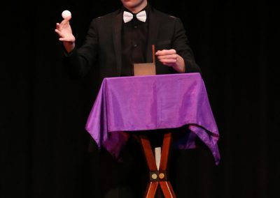 Dean Leavy performs a magic act with a table