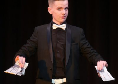 Dean Leavy performs a magic act with ripped paper