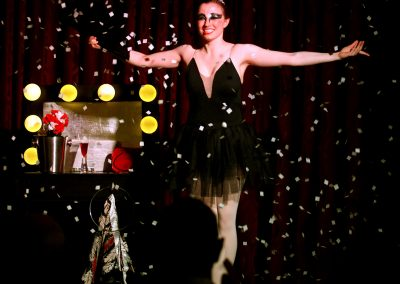Megan Swann stands for applause at the end of her ballet magic act