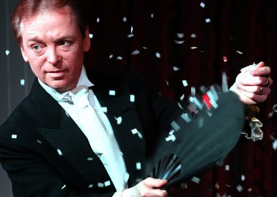 Scott Penrose performs a magic act with a fan