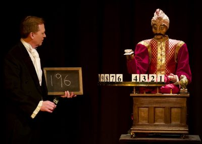 Scott Penrose performs a magic act with Psycho the automaton