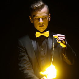 Dean Leavy performing magic with fire