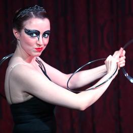 Megan Swann performing a magic act